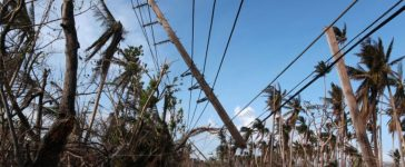 FILE PHOTO: Cars drive under a partially collapsed utility pole, after the island was hit by Hurricane Maria in September, in Naguabo, Puerto Rico October 20, 2017. (Photo: REUTERS/Alvin Baez/File Photo)
