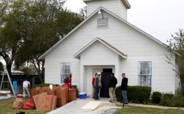 People stand outside the site of the shooting at the First Baptist Church of Sutherland Springs, Texas, November 9, 2017. REUTERS/Rick Wilking