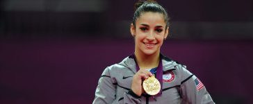 Gold medalist Alexandra Raisman of the United States poses on the podium during the medal ceremony for the Artistic Gymnastics Women's Floor Exercise final on Day 11 of the London 2012 Olympic Games at North Greenwich Arena on August 7, 2012 in London. (Photo by Michael Regan/Getty Images)