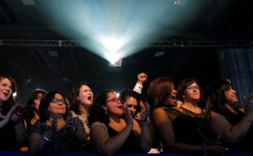 Audience members cheer as U.S. Democratic presidential nominee Hillary Clinton speaks at the Congressional Hispanic Caucus Institute's 39th Annual Gala Dinner in Washington, DC, U.S. September 15, 2016. REUTERS/Brian Snyder