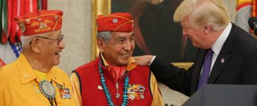 President Donald Trump greets members of the Native American code talkers during an event in the Oval Office of the White House, on November 27, 2017 in Washington, D.C. (Photo by Oliver Contreras-Pool/Getty Images)