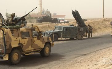 Iraqi forces members and coalition forces gather on September 23, 2017 as they advance to recapture the insurgent stronghold of Hawija after retaking the nearby northern town of Sharqat from the Islamic State (IS) group on the second day of a new offensive. AHMAD AL-RUBAYE/AFP/Getty Images