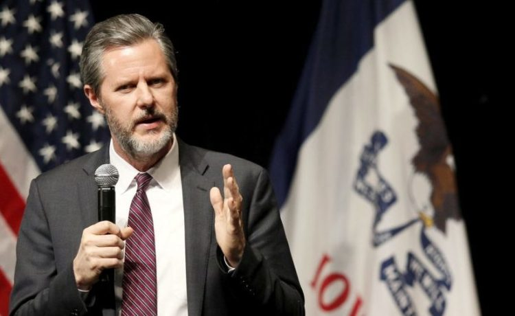 Jerry Falwell Jr., president of Liberty University, introduces U.S. Republican presidential candidate Donald Trump at a campaign town hall in Davenport, Iowa January 30, 2016. REUTERS/Rick Wilking/File Photo