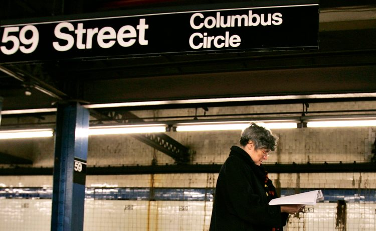 A women waits for a train in the Columbus Circle Subway Station in New York City December 13, 2005. The Transit Workers Union's members have voted to authorize the first strike since 1980 unless a new contract is reached with the Metropolitan Transportation Authority (MTA) before the current contract expires at midnight on December 15. REUTERS/Peter Foley - RP2DSFIODHAB