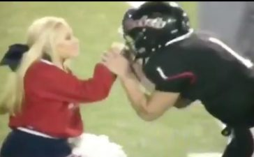 QB and cheerleader (Credit: Screenshot/Twitter Video OfficialCSO)