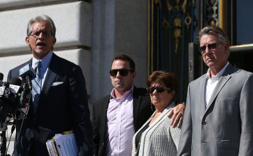 SAN FRANCISCO, CA - SEPTEMBER 01: (L-R) Attorney Frank Pitre speaks as Brad Steinle, Liz Sullivan and Jim Steinle, the family of Kate Steinle who was killed by an undocumented immigrant, look on during a news conference on September 1, 2015 in San Francisco, California. The family of Kate Steinle who was killed by an undocumented immigrant, have filed claims against San Francisco Sheriff Ross Mirkarimi, the Bureau of Land Management and Immigration and Customs Enforcement for their role in their daughter's death. (Photo by Justin Sullivan/Getty Images)