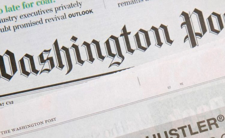 A photo taken on October 15, 2017 in in Washington, DC shows a full-page newspaper advertisement in the Washington Post offering 10 million dollars from Hustler Magazine publisher Larry Flynt for information leading to the impeachment and removal from office of US President Donald Trump. (Photo: SAUL LOEB/AFP/Getty Images)