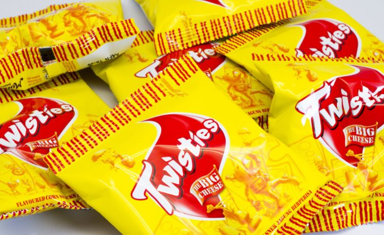 Cheese flavoured Twisties Snacks. Twisties are a type of cheese curl, corn-based snack food product launched in 1950 by the General Foods Corporation. [Shutterstock - Faiz Zaki]