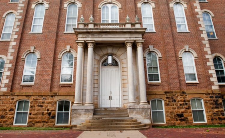 The Old Main with Senior Walk is the oldest building on the University of Arkansas campus. (Shutterstock/Natalia Bratslavsky)