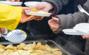 Warm Food For The Homeless (shutterstock/ wjarek)