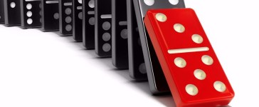 cause effect dominoes Shutterstock/cigdem