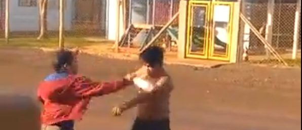 Man takes a bottle to the face (LiveLeak / Screenshot).