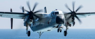 """In this U.S. Navy handout, a C-2A Greyhound logistics aircraft assigned to the """"Rawhides"""" of Fleet Logistics Support Squadron (VRC) 40 prepares to land on the flight deck of the aircraft carrier USS George H.W. Bush (CVN 77) on March 7, 2017 in the Mediterranean Sea. The ship and its carrier strike group is conducting naval operations in the U.S. 6th Fleet area of operations in support of U.S. national security interests. Mass Communication Specialist 3rd Class Christopher Gaines/U.S. Navy via Getty Images."""