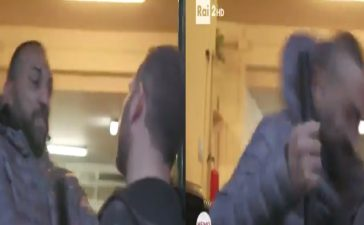 Alleged mobster headbutts journalist (Screenshot).