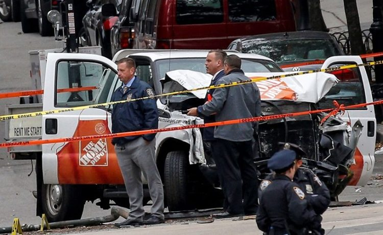 Police investigate a pickup truck used in an attack on the West Side Highway in lower Manhattan in New York