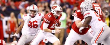 INDIANAPOLIS, IN - DECEMBER 02: Alex Hornibrook #12 of the Wisconsin Badgers runs with the ball against the Ohio State Buckeyes in the Big Ten Championship at Lucas Oil Stadium on December 2, 2017 in Indianapolis, Indiana. (Photo by Andy Lyons/Getty Images)
