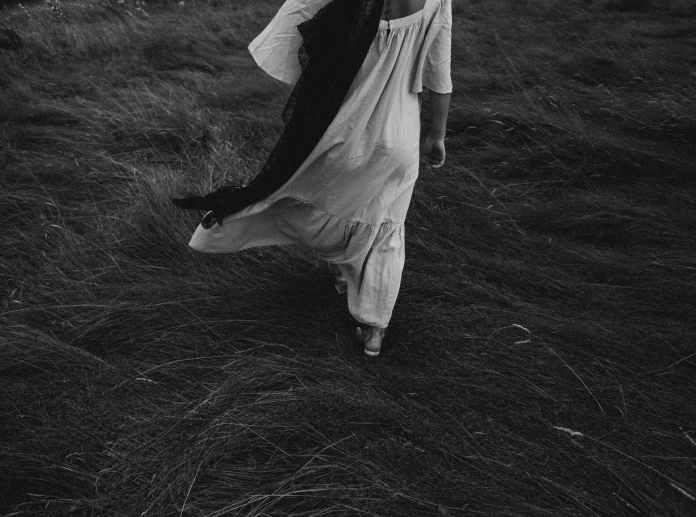 woman walking on grass