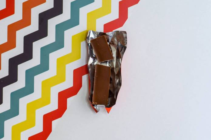 brown chocolate bar on multicolored surface