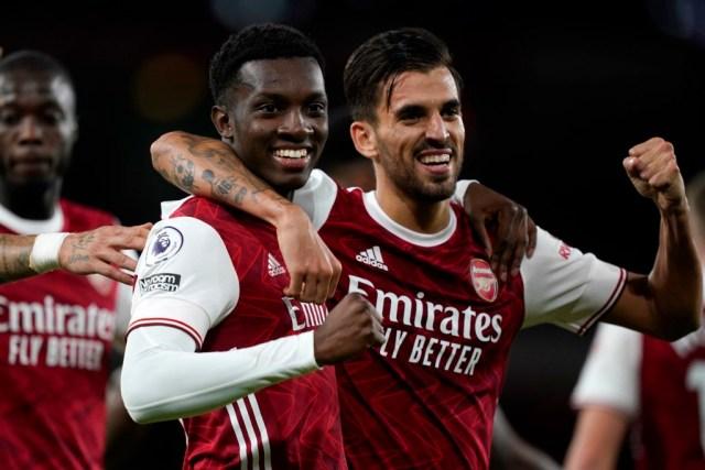 LONDON, ENGLAND - SEPTEMBER 19: Eddie Nketiah of Arsenal celebrates with teammate Dani Ceballos after scoring his team's second goal during the Premier League match between Arsenal and West Ham United at Emirates Stadium on September 19, 2020 in London, England. (Photo by Will Oliver - Pool/Getty Images)