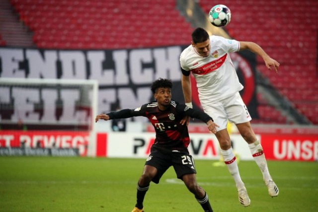 28.11.20, VfB Stuttgart - FC Bayern Münich: Kingsley Coman contests a header with Konstantinos Mavropanos. Photo: Pressefoto Rudel / Robin Rudel / Pool / Pressefoto Rudel Stuttgart Baden-Württemberg Deutschland