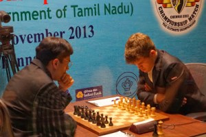 Viswanathan Anand across from Magnus Carlsen in round 1. (source: http://susanpolgar.blogspot.com/)