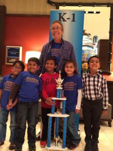Coach Joe Lonsdale stands with the MSJE k-1 Chess Team.