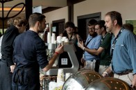 Grabbing an espresso between lectures. In the foreground is Mark Stell of Portland Roasting ordering a drink from Christian Ullrich.