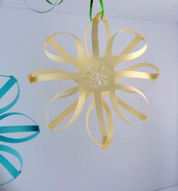 Hang your 3d paper snowflake with a ribbon