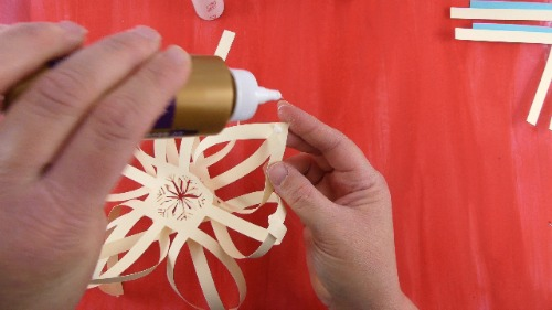 Glue the 2 sides of the paper snowflake together