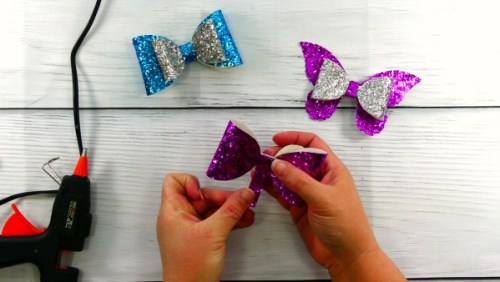 Glue the center strip to the DIY glitter hair bows made with a Cricut explore