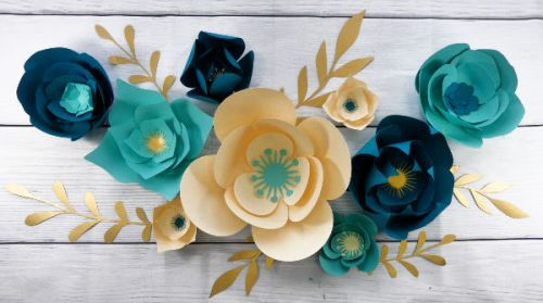 Teal Paper flower wall display mad eiwht a Cricut cutting machine