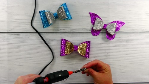 glue the glitter hair bow to the clip