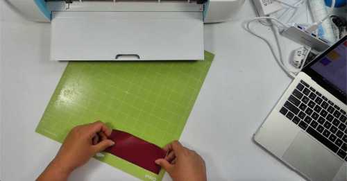 place vinyl on cutting mat for cricut to cut the vinyl