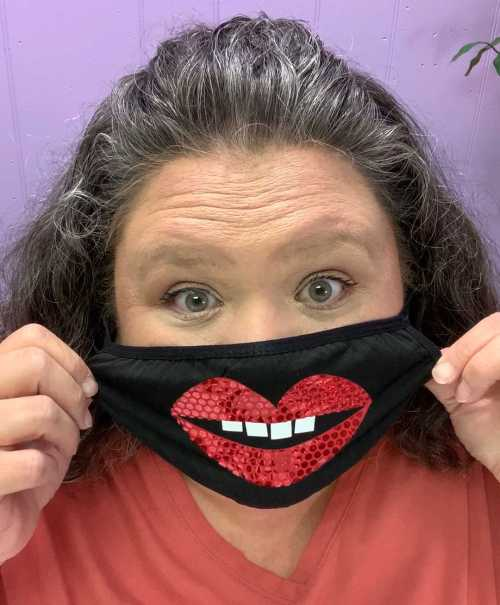 wearing a black face mask with lips SVG made with Cricut