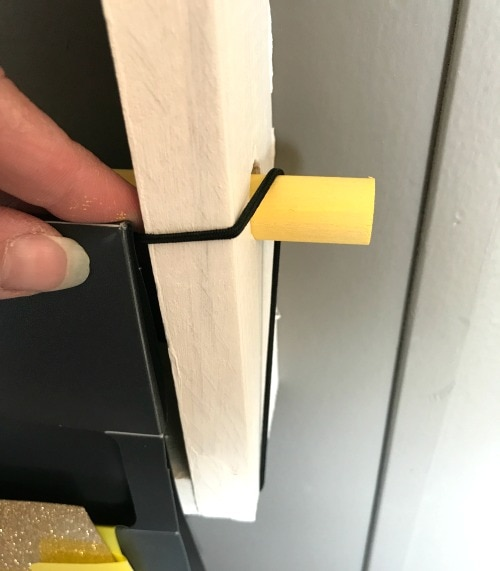 Attaching the wall organizer to the vinyl roll rack