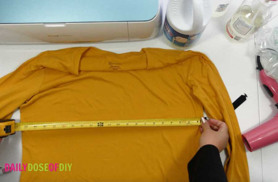 Measuring a shirt to size the design for bleach spray shirts