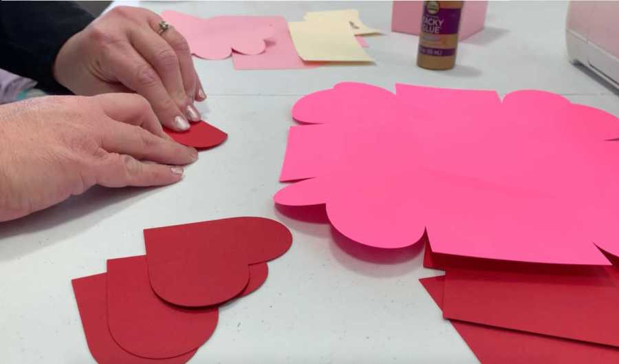 folding red hearts for the exploding box