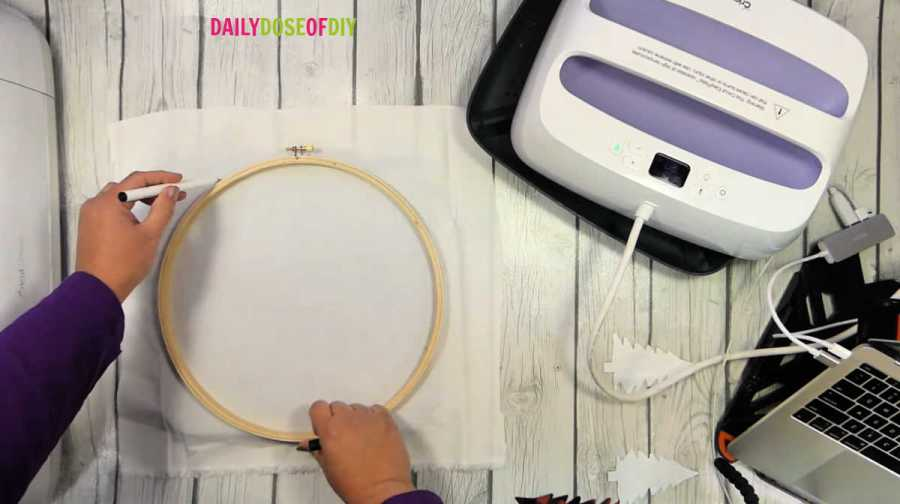 trace outside the hoop  with a pen to properly center your design