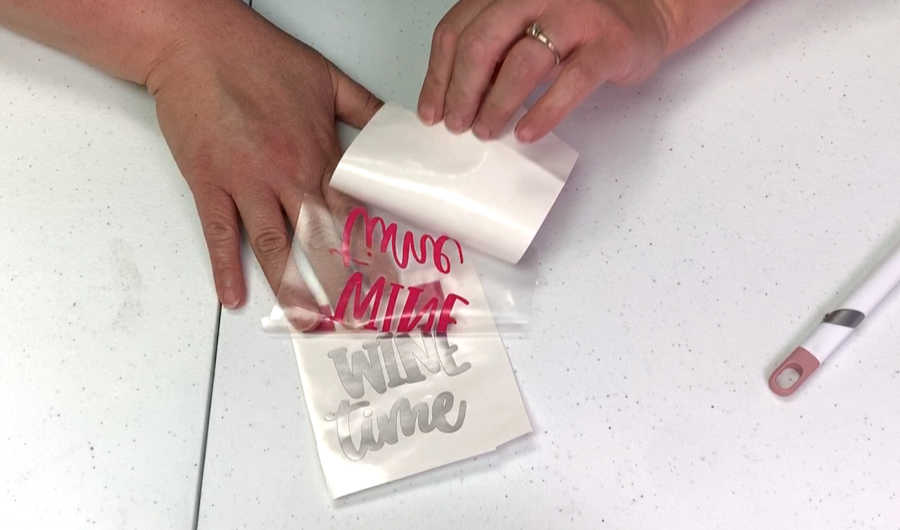 remove backing from adhesive vinyl to layer vinyl on top of vinyl