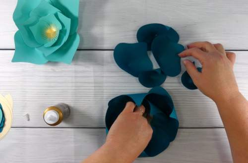 Assembling a paper flower to make a paper flower display