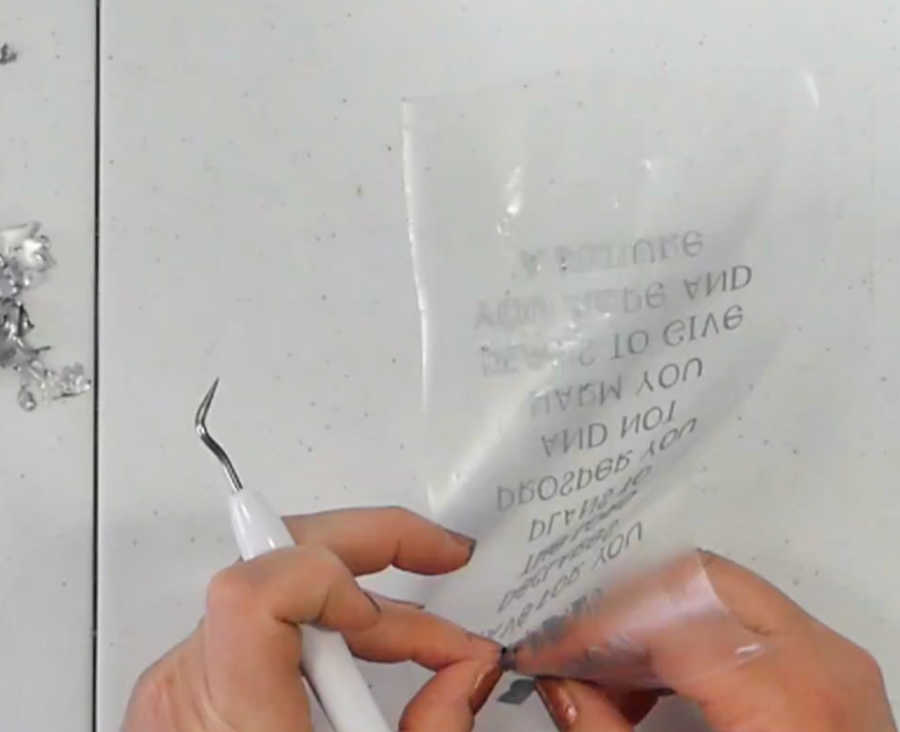 Use your weeding tool to help you remove pieces of extra vinyl from the transfer tape when you are reverse weeding.