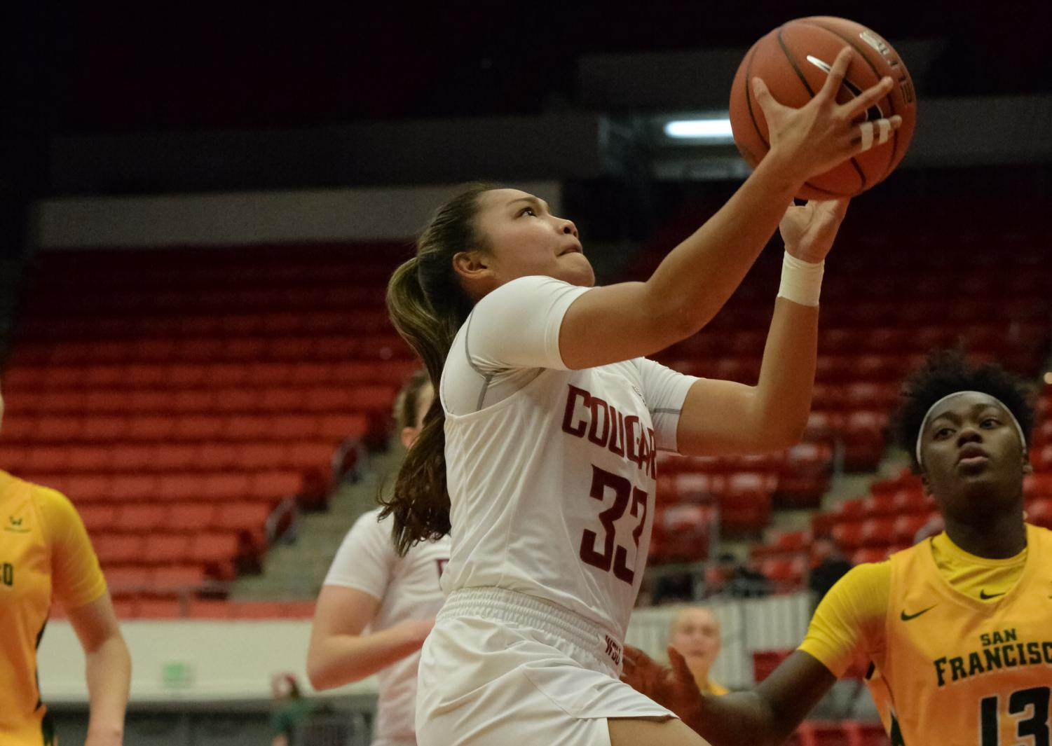hight resolution of freshman guard cherilyn molina runs up the court for a layup against san francisco on nov