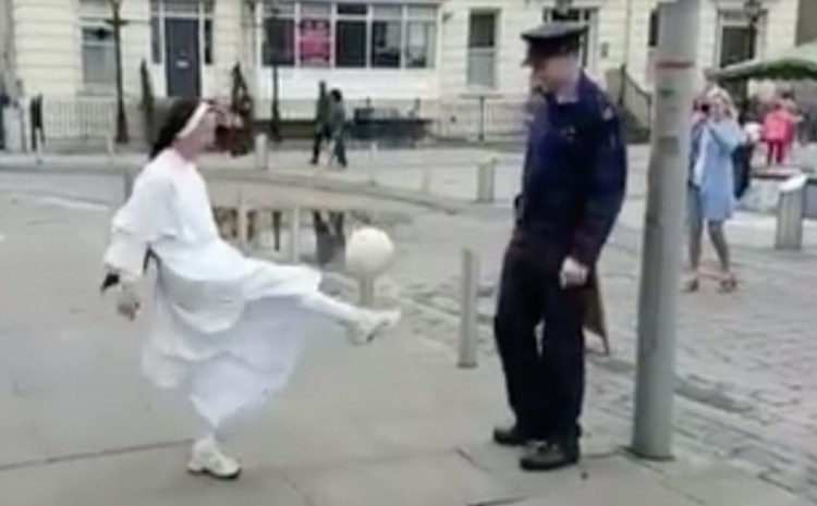 See what a Nun and Cop have in common with a soccer ball at street fair