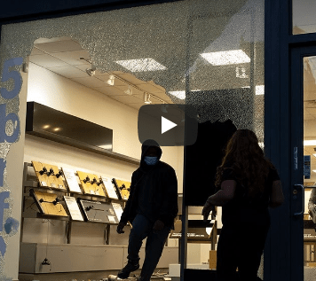 Looters strike luxury shops around NYC before curfew sets in