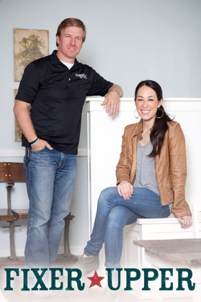 Hosts Chip and Joanna Gaines in the Erwin's newly remodeled kitchen, as seen on HGTV's Fixer Upper.