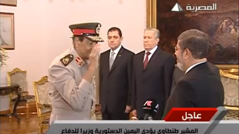 Field Marshall and Defence Minister Mohamed Tantawi salutes President Mohamed Morsy during the presidential oath swearing ceremony televised on the state run Al-Masrya channel, 30 June SCREEN GRAB / AL-MASRYA