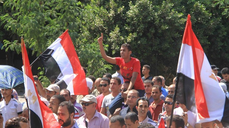 Protesters march towards the Ministry of the Interior building in Downtown Cairo on 24 August Mohamed Omar