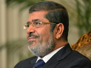 """In response to questions on whether the Muslim Brotherhood influences his presidential decisions, Morsi said that his """"background with the Brotherhood is part of my psychology, humanity and belief"""". (AFP Photo)"""