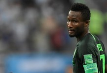 Nigeria's midfielder John Mikel Obi reacts during the Russia 2018 World Cup Group D football match between Nigeria and Argentina at the Saint Petersburg Stadium in Saint Petersburg on June 26, 2018. / AFP PHOTO / GABRIEL BOUYS