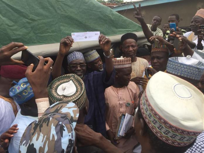 Malam Ibrahim Shekarau displays his APC membership card at his Giginyu Ward on Sunday, September 9, 2018